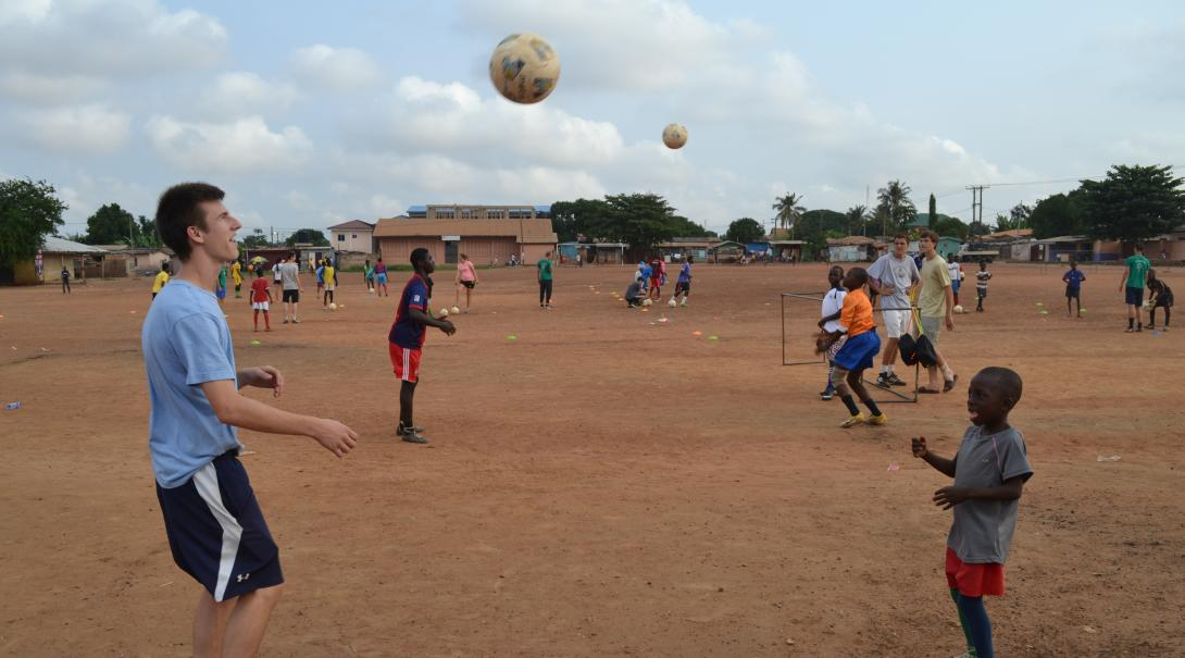 Volunteer as a football coach in Ghana and teach a youth team various footwork, passing, and ball control techniques.